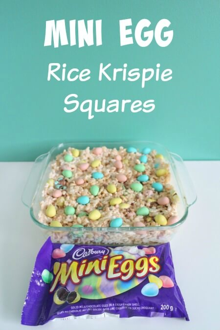 Mini egg rice krispie sqaures in glass baking dish with bag of mini eggs in front