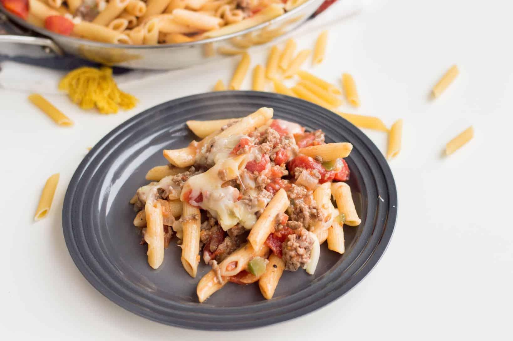 Cheeseburger pasta on a grey plate